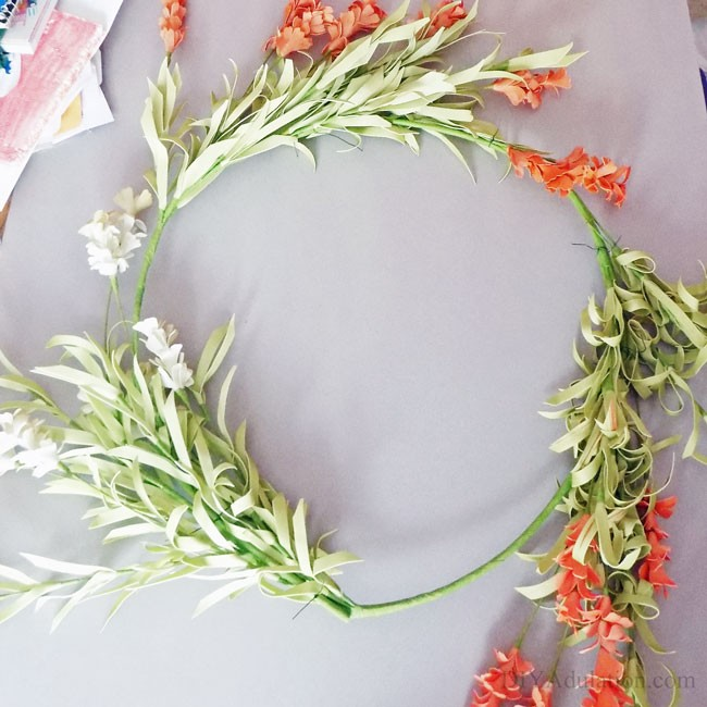 Celebrate the season with this gorgeous DIY spring wreath. You'll love having this bright and cheery wreath welcome you every day during this spring.
