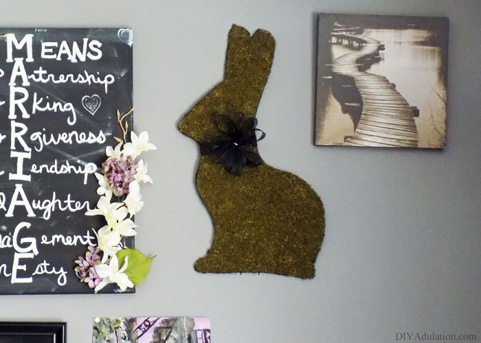 Make this beautiful DIY moss bunny wall art for a fraction of what it would cost you in the store! It is the perfect addition to your Easter decor.