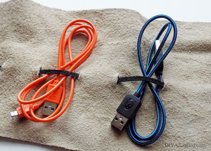 This DIY leather charging cord organizer holds your cords and wall adapters to keep everything in one place. Perfect for yourself or as an easy DIY gift!