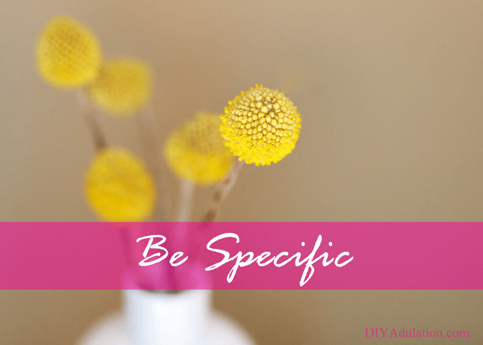 Yellow flowers in vase with text overlay - be specific