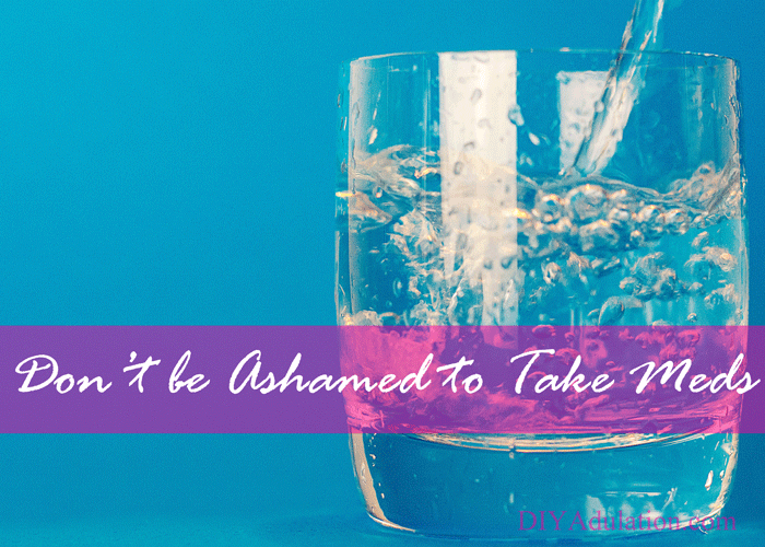 Glass of water with text overlay - Don't be ashamed to take meds