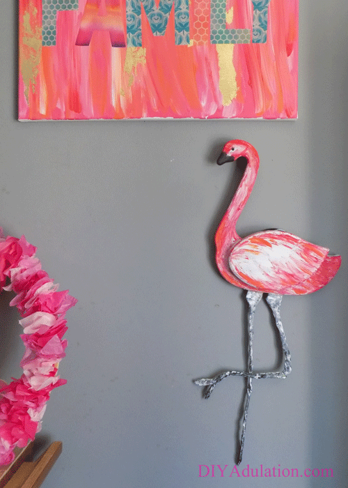 See the newest makeover at the Thrift Store Decor Upcycle Challenge! Turn an ugly thrift store goose into an awesome pink flamingo wall hanging.