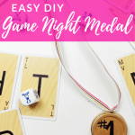 Game Night Medal next to Cards and Die with text overlay - Easy DIY Game Night Medal - DIY Adulation