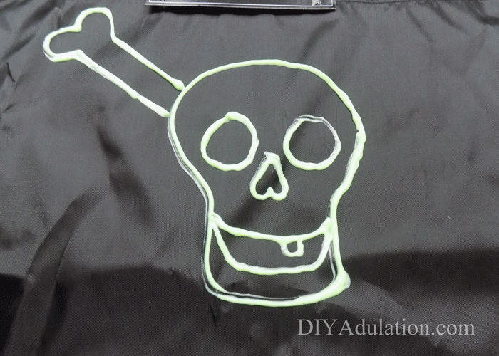 This DIY glowing pirate trick-or-treat bag lets you coordinate the entire buccaneer look, increases visibility of your kid, and frees up little hands.