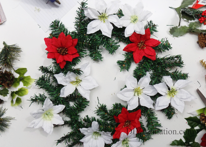 Get your front door ready for the holidays with this DIY glittery Merry Christmas floral wreath that proves gorgeous decor doesn't have to blow your budget!