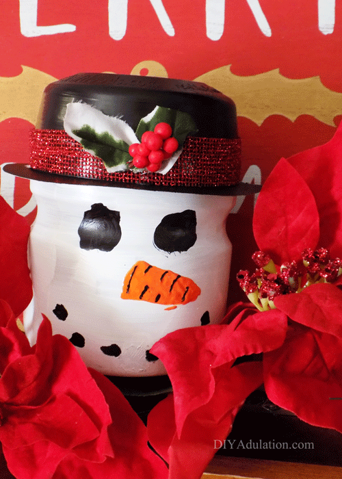Give your treats a festive home for the holidays with this adorable upcycled snowman treat jar :: the perfect inexpensive holiday hostess gift!
