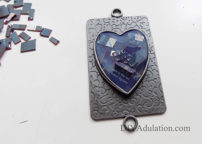 Credit Card Pieces inside heart pendant covered in final layer of jewelry pendant gel