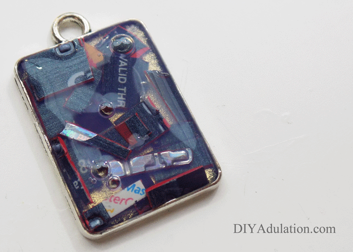 Credit Card Pieces inside rectangle keychain base covered in final layer of jewelry pendant gel