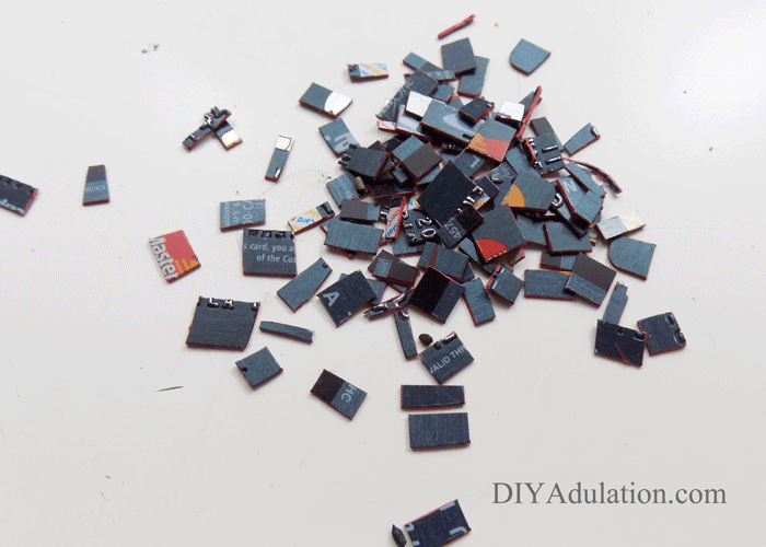 Tiny pieces of cut up credit cards