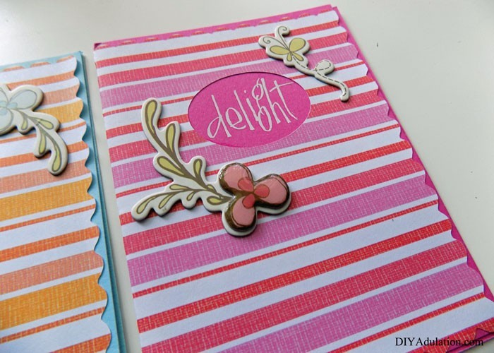 Close up of Delight Striped Pink Greeting Card with Flower and Butterfly Embellishments on the Front