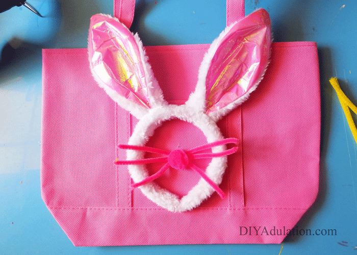 Pink Tote Bag with Pink Fuzzy Bunny Ears Headband, pipe cleaner whiskers, and a pompom nose