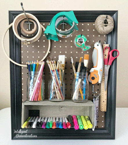 Framed Peg Board with Craft Supplies Organized on it