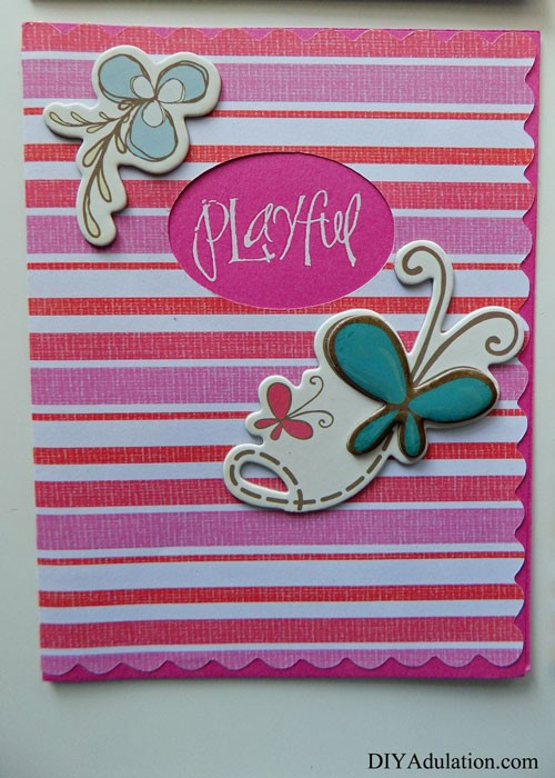 Pink Striped Playful Card with Flower and Butterfly Embellishments on the Front