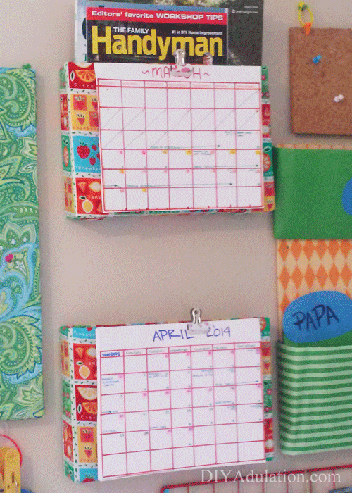 Magazine holders on a wall with calendars