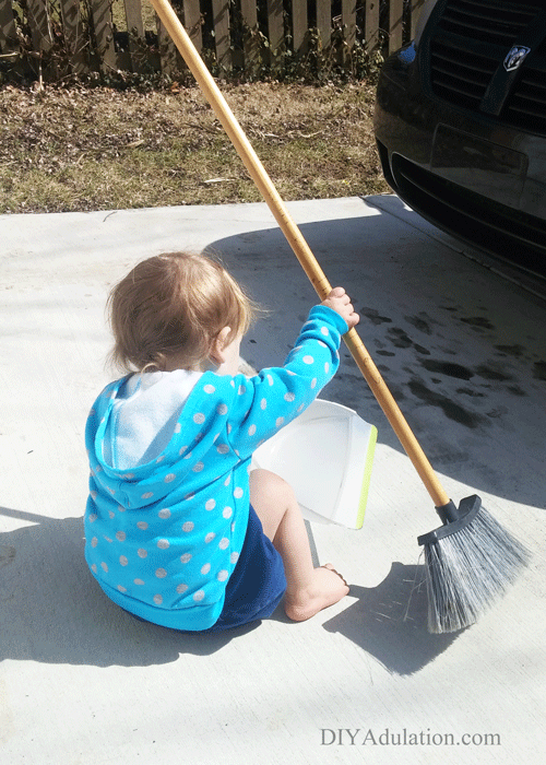 Toddler Sweeping Driveway