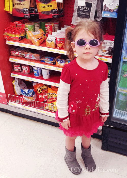 Little Girl Dressed in Crazy Outfit in Checkout Lane