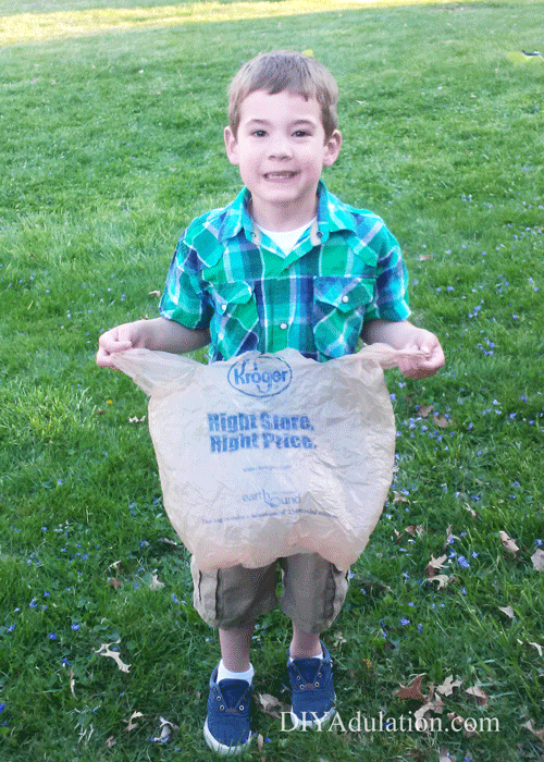 Young Boy Carrying Plastic Grocery Bag