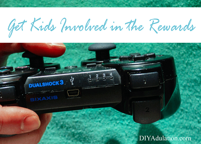 Hand holding a Playstation controller with text overlay: Get Kids involved in the Rewards