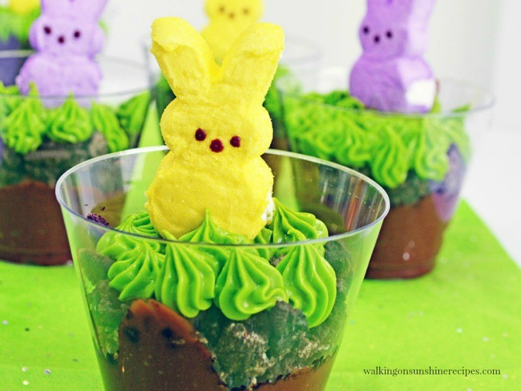Pudding cups with green frosting grass and bunny Peeps on top