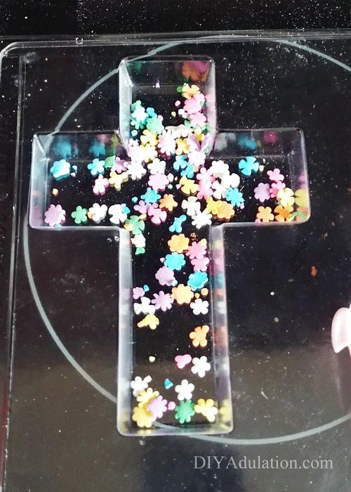 Sprinkles in a Plastic Cross Mold