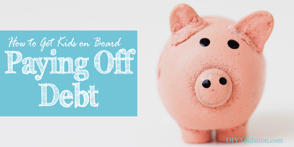 Clay Pig with text overlay: How to Get Kids on Board with Paying Off Debt