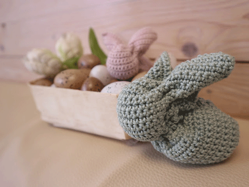 Gray crocheted bunny with decor in the background
