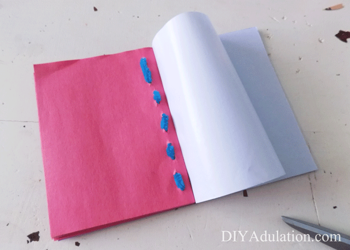 Bound construction book attached to glitter foam