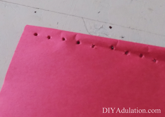 Holes punched in construction paper