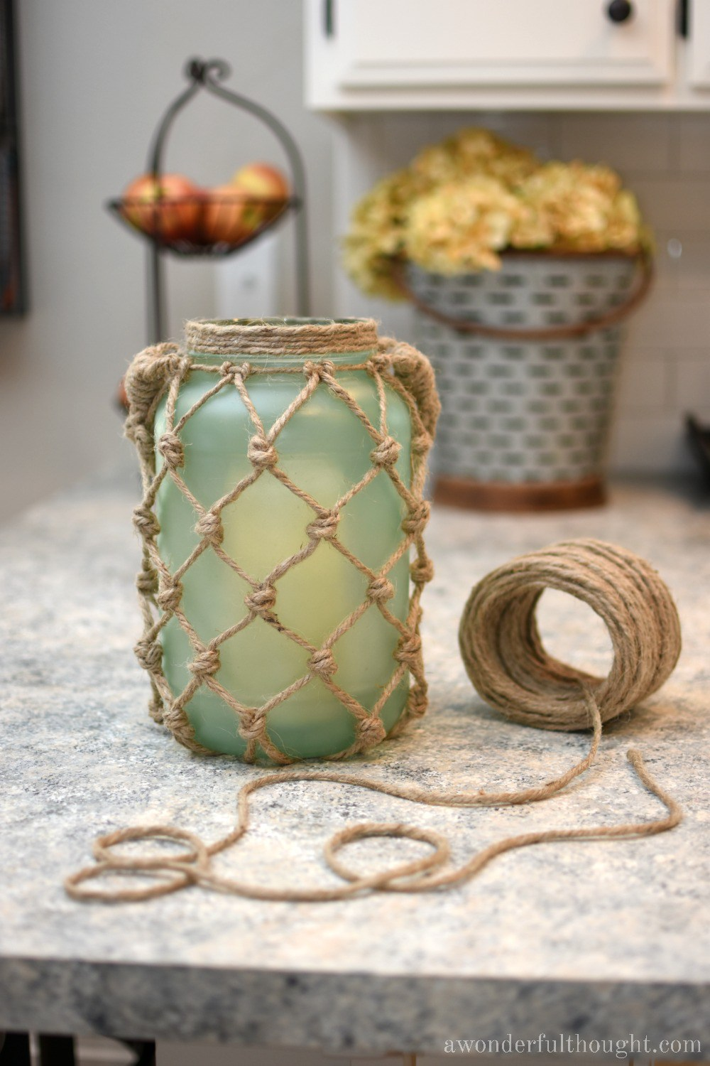 sea glass rope lantern on a counter