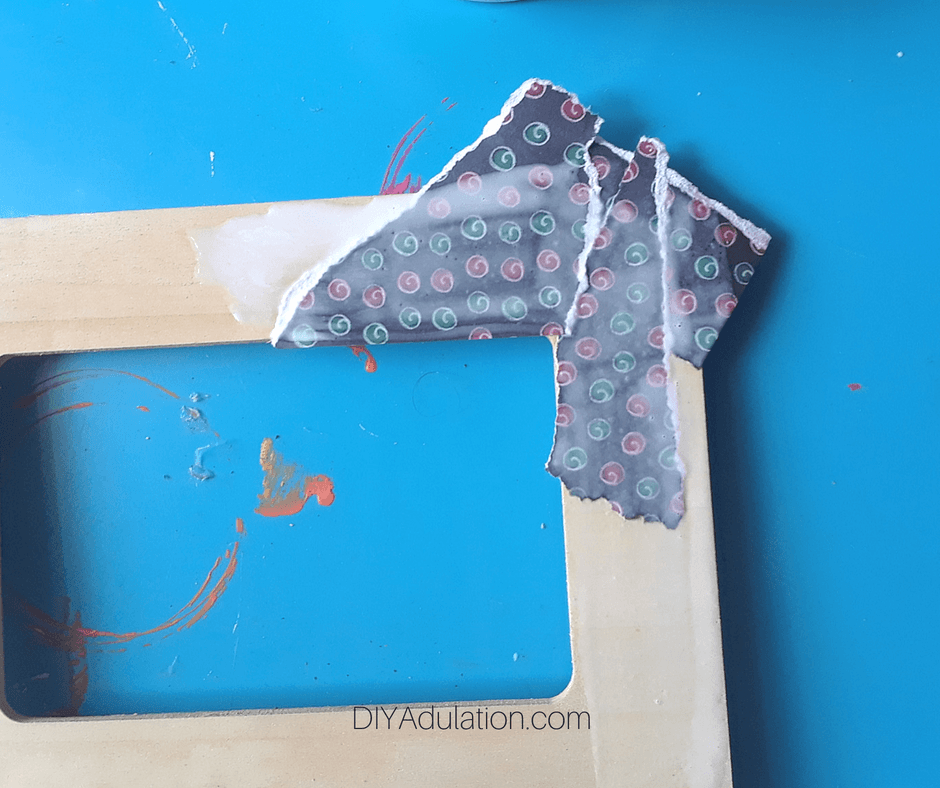 Pieces of Paper Glued to Corner of Wooden Frame