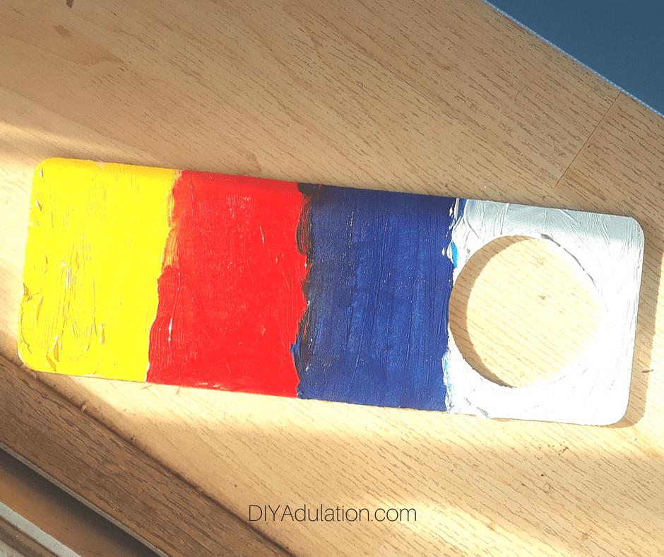 Primary Color Stripes on Door Hanger