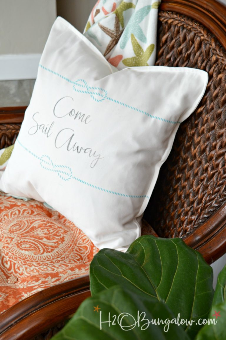 Come Sail Away pillow in a chair