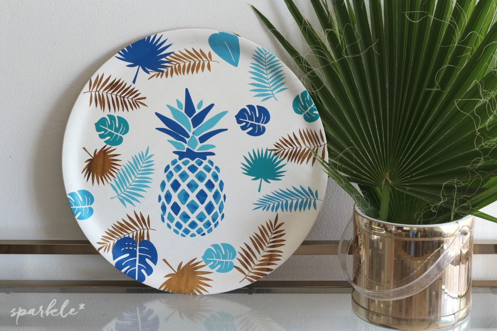 Blue pineapple serving tray next to plant