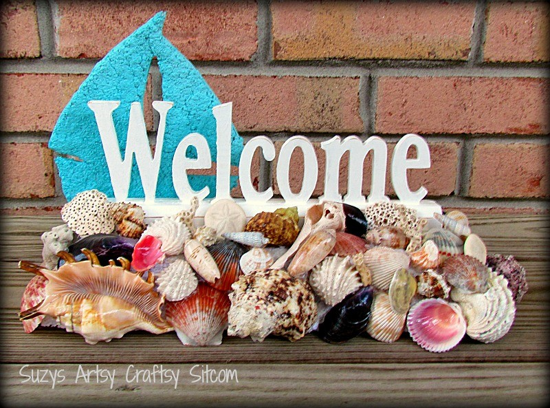 Shell covered welcome sign
