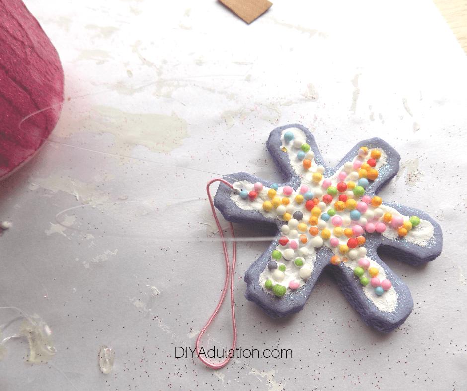 Clear Thread through Purple Snowflake Cookie Ornament