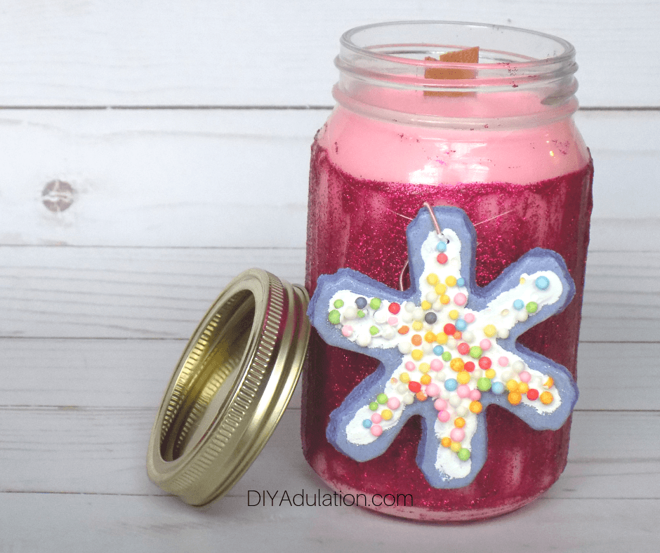 Pink Glitter Jar Candle next to Lid