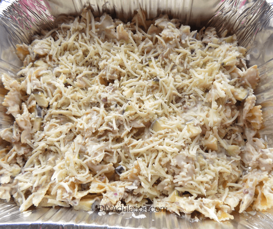 Cheese on top of Uncooked Alfredo Mixture in Pan
