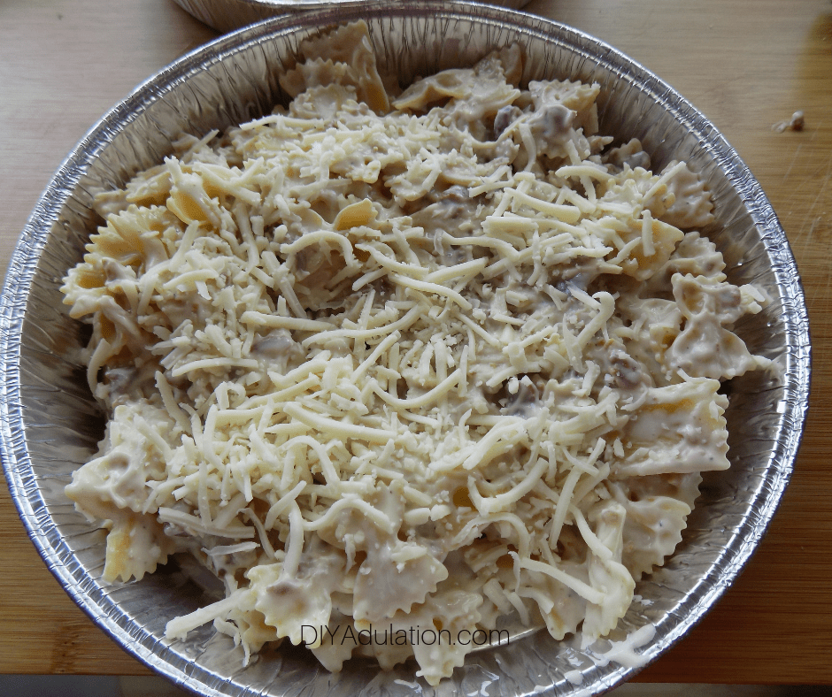 Round Pan full of Alfredo Mixture Topped with Cheese