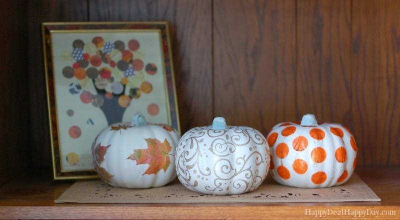 Small glitter pumpkins styled on bookshelf