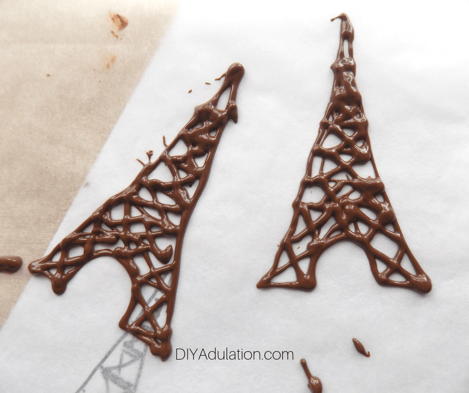 2 Chocolate Eiffel Towers Next to Each Other
