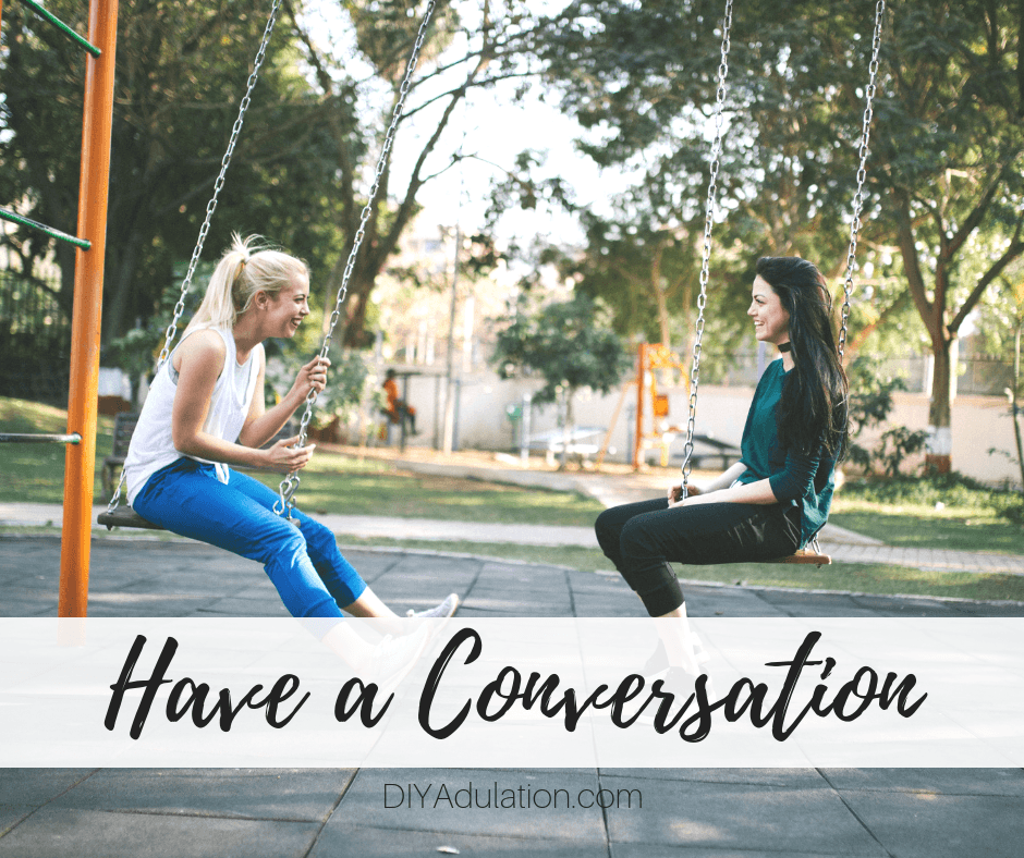 2 Women Sitting on Swings with text overlay_ Have a Conversation