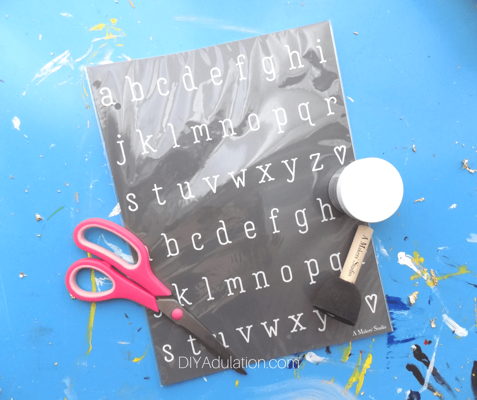 Alphabet stencils with paint dome brush and scissors