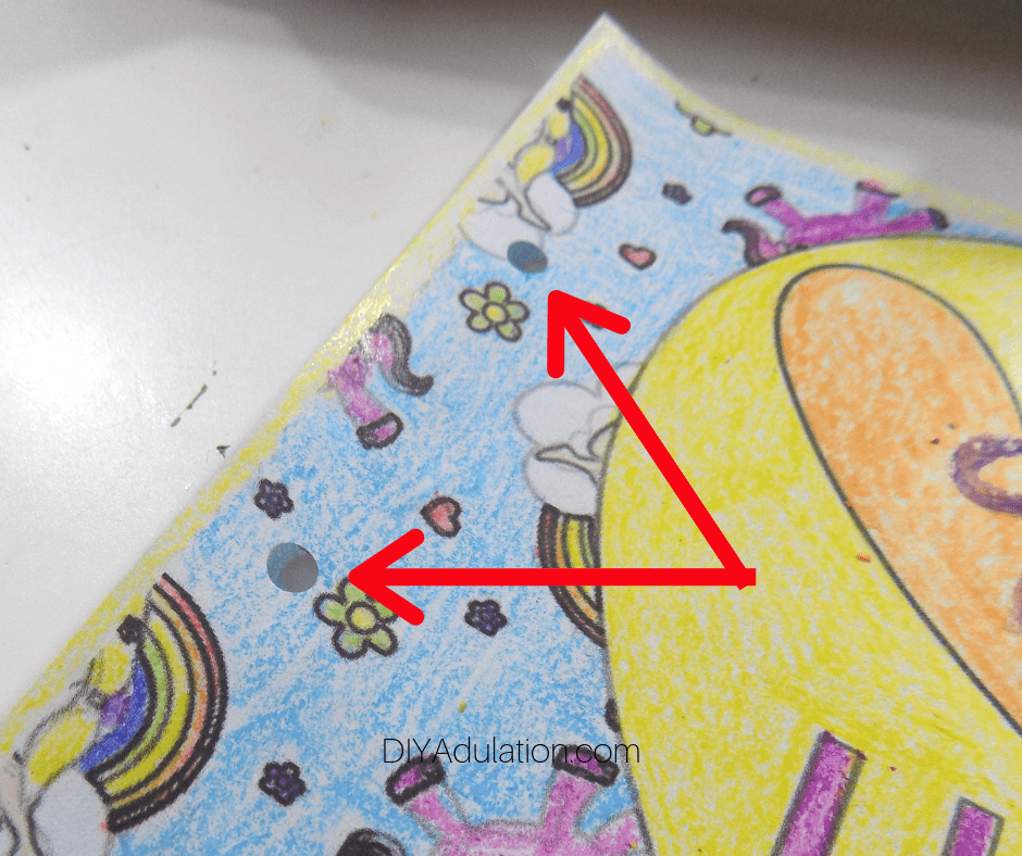 Arrows Pointing to Holes in Book Cover