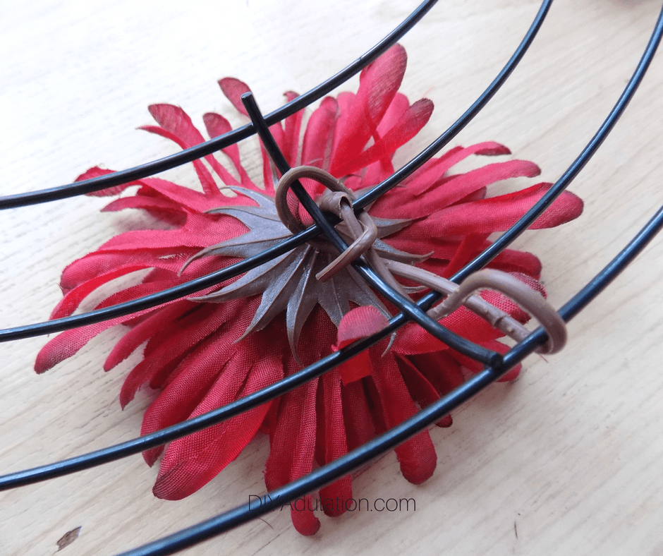 Back of Red Flower Wrapped Around Wire Wreath Form