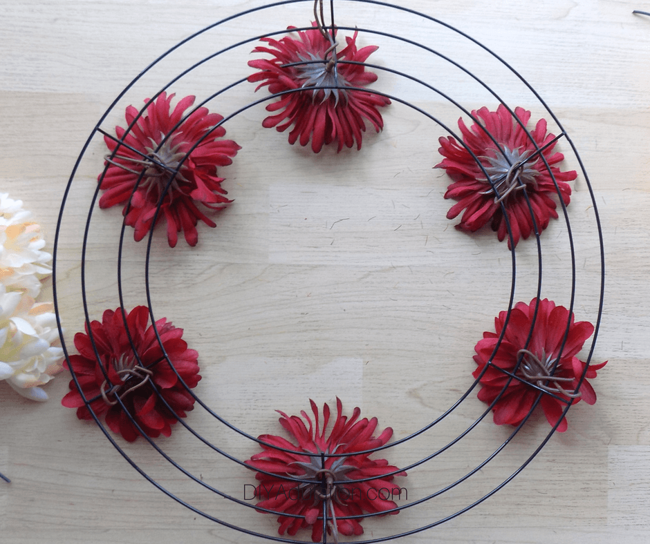 Back of Red Flowers Wrapped Around Wire Wreath Form