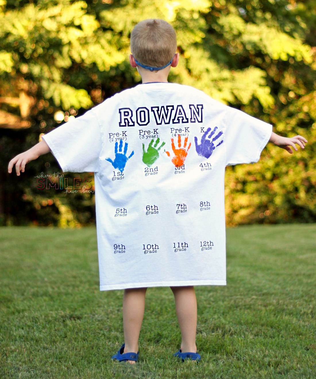 Large white t-shirt on child with painted handprints