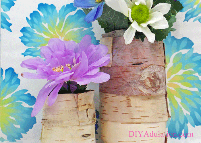 Birch Bark vases with fake flowers inside