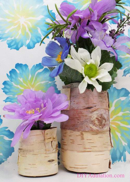 flower arrangements in birch bark vases
