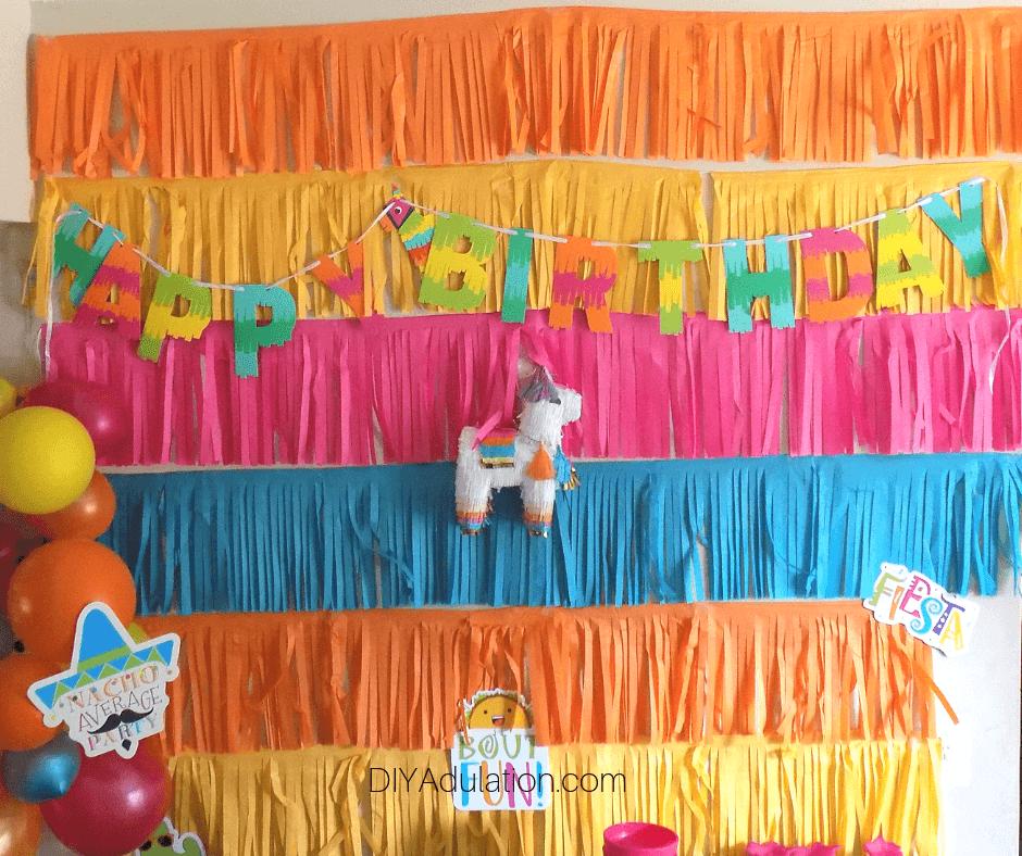 Birthday Banner and Mini Pinata on Fringe Background