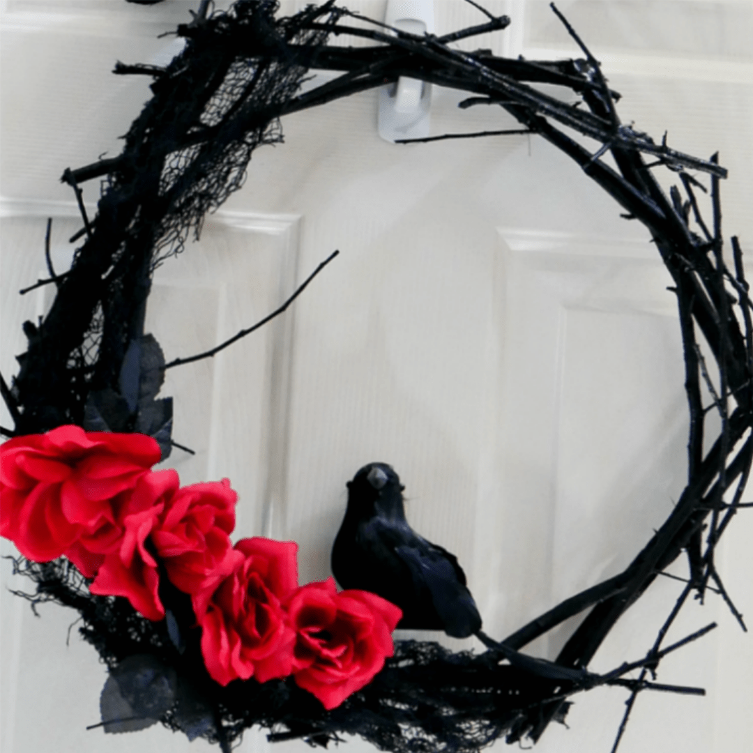Black Twig Wreath with Red Roses and a Crow